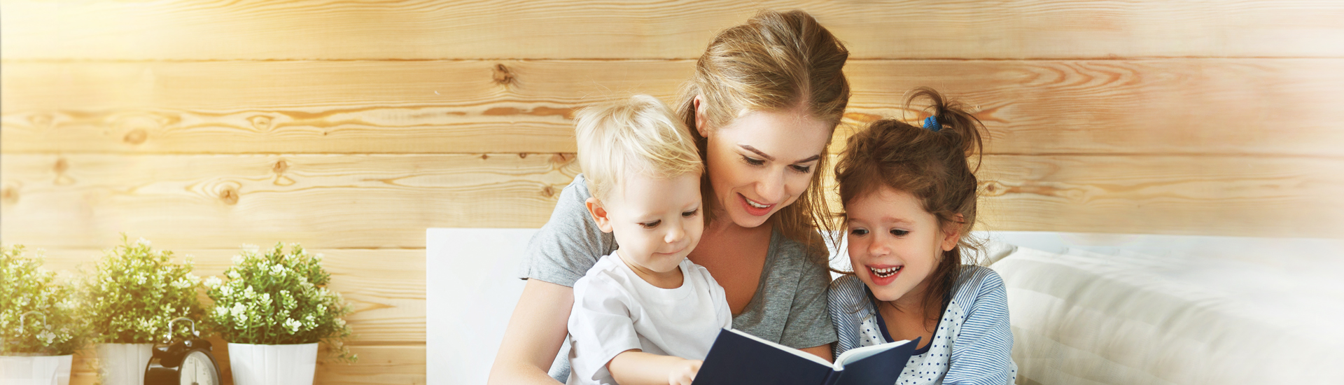 mom and children reading